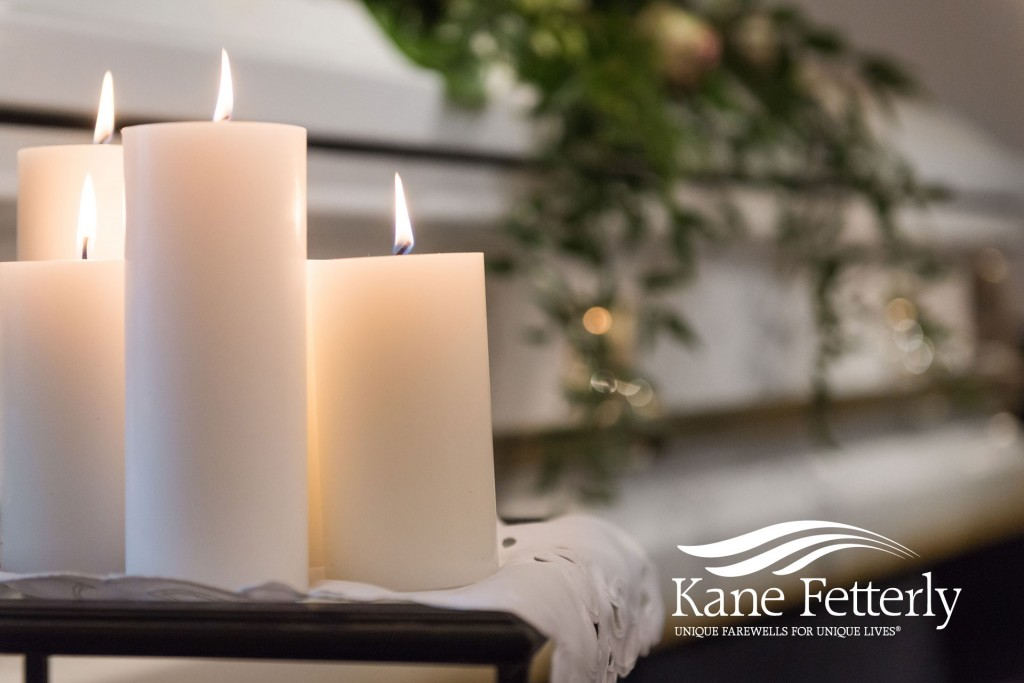 The warm glow of candlelight during a funeral at Kane Fetterly