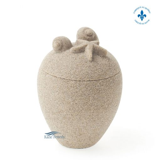 Sand miniature urn with seashells and starfish