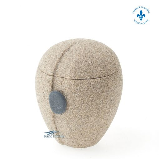 Sand miniature urn with shore pebble