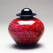 Red hand-blown glass urn
