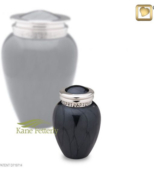 Charcoal grey brass miniature urn with pearlescent finish and silver accents with engraved floral motif around the lid.