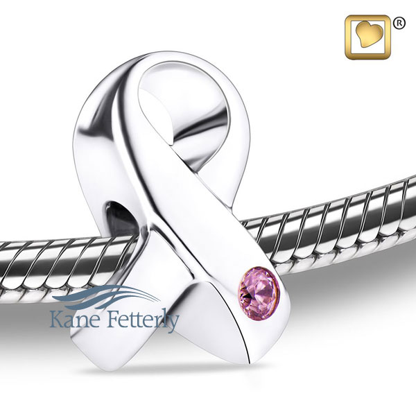 J0242 Ribbon bead with pink crystal
