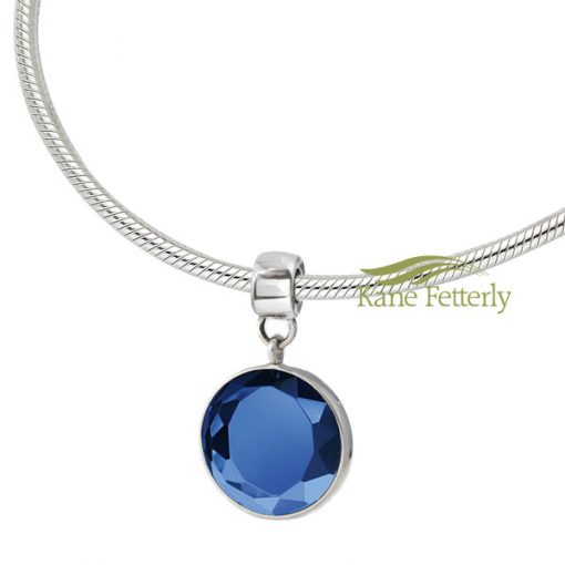 Necklace and round bead with cut-glass blue crystal gem