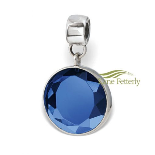 Sterling silver round bead with cut-glass blue crystal gem.