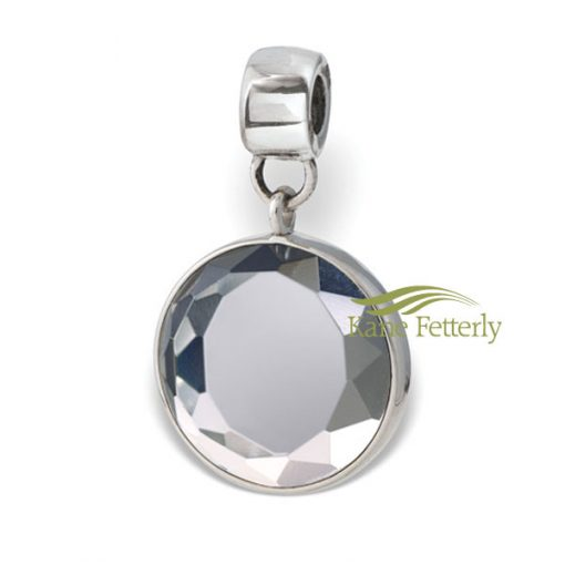 Sterling silver round bead with cut-glass clear crystal gem.