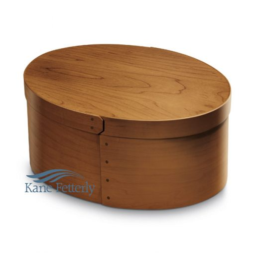 Oval hardwood urn with medium stain and satin finish