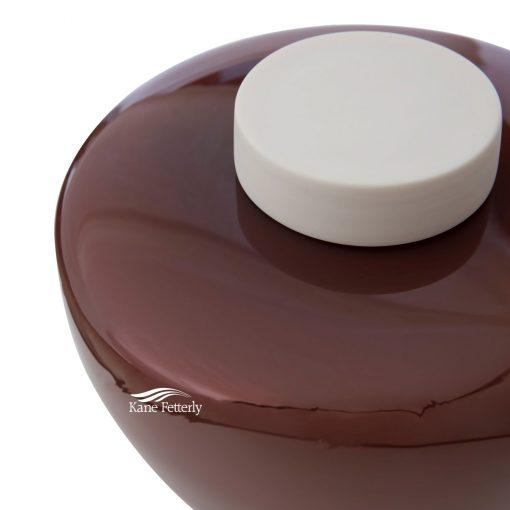 Brown hand-blown glass urn