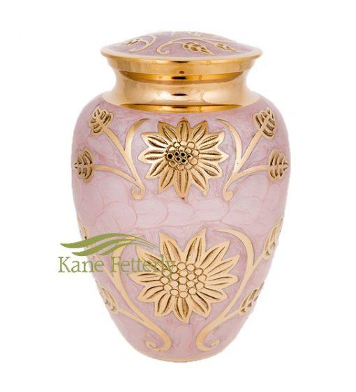 Urne en laiton dotée de tournesols dorés, finition nacrée rose.