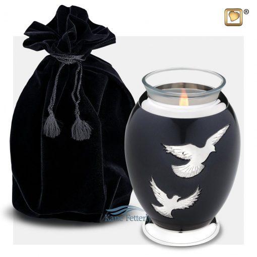 Tealight candle holder shown with velvet bag