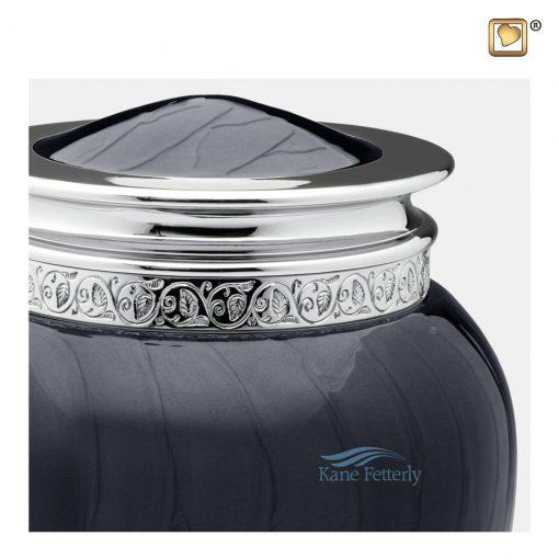 Dark grey-blue brass urn.