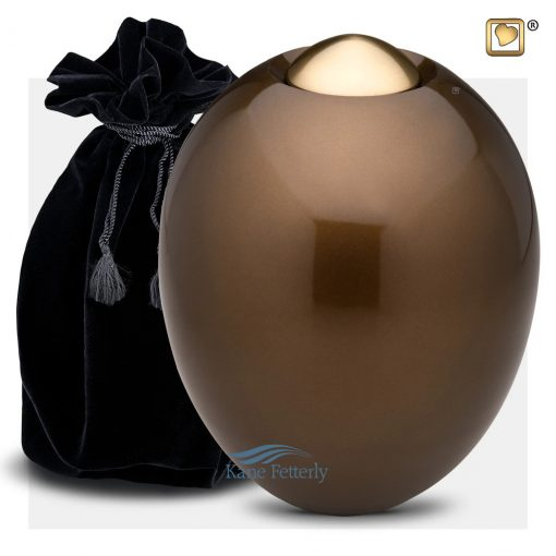 Brown oval urn with gold accents (shown with velvet bag)