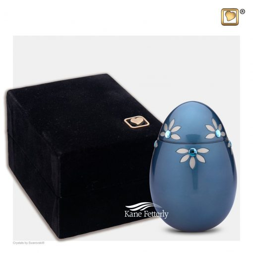 Oval miniature urn shown with velvet box