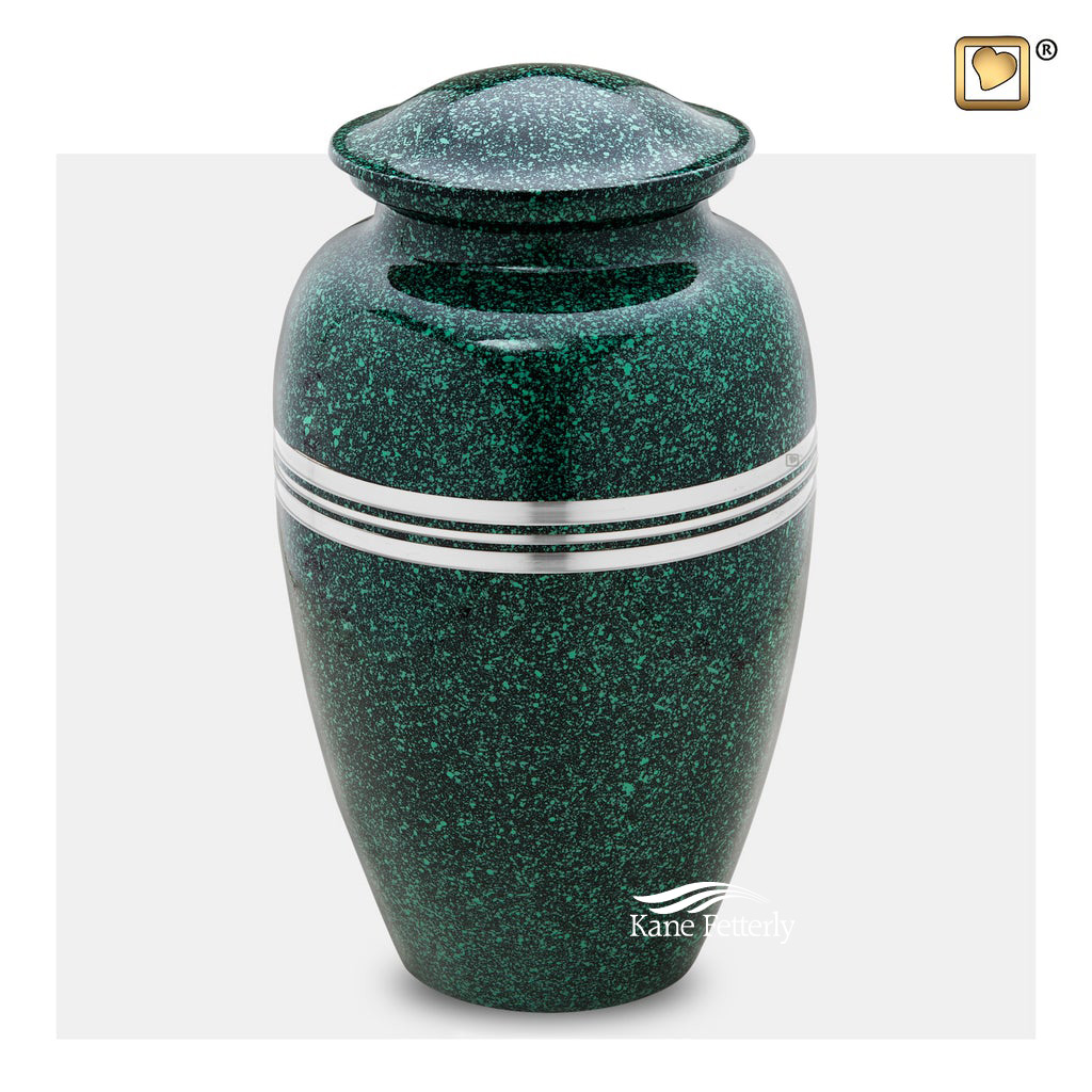 Brass urn with green speckled finish