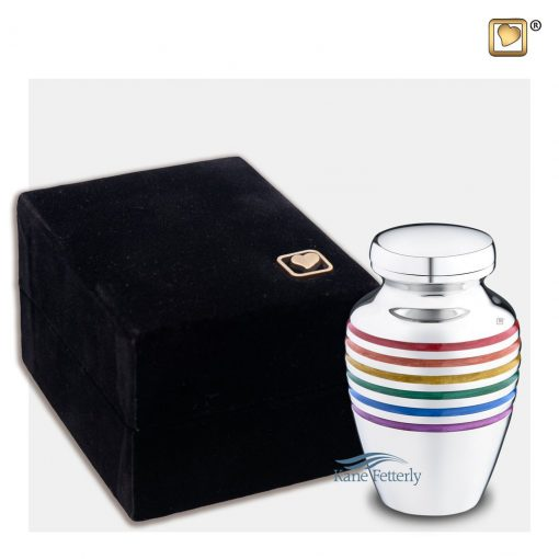 Brass miniature urn with pride rainbow bands shown with box