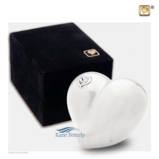 Pearl white heart miniature urn shown with box