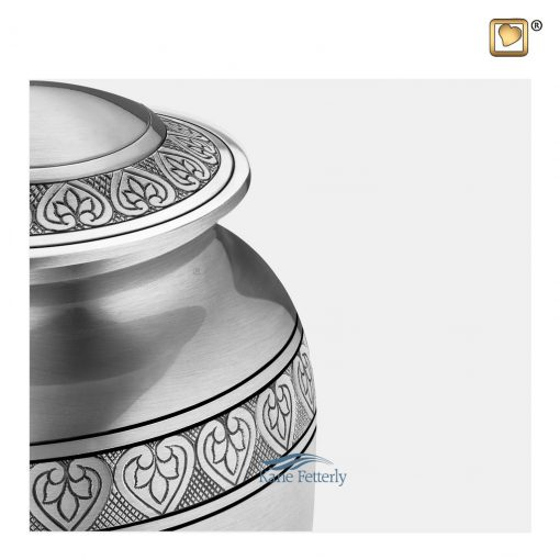 Silver brass urn with hearts