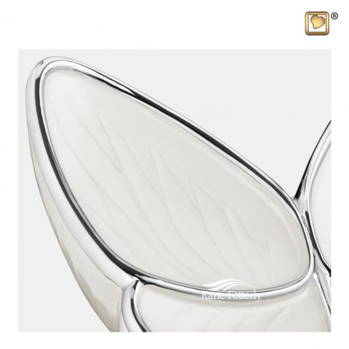 Butterfly urn in brass and aluminum, white pearlescent finish.