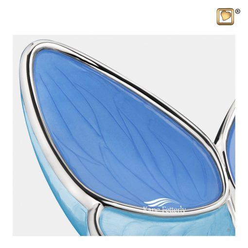 Urne papillon en laiton et aluminium, finition perlée bleue bicolore.